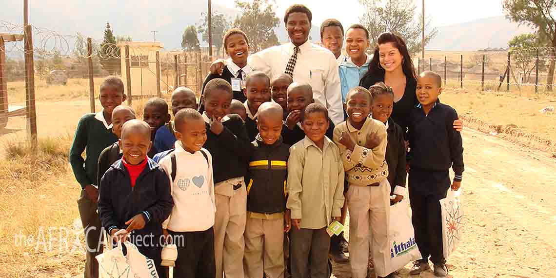 Marcella and Mahaye on the road with children from the primary school nearby