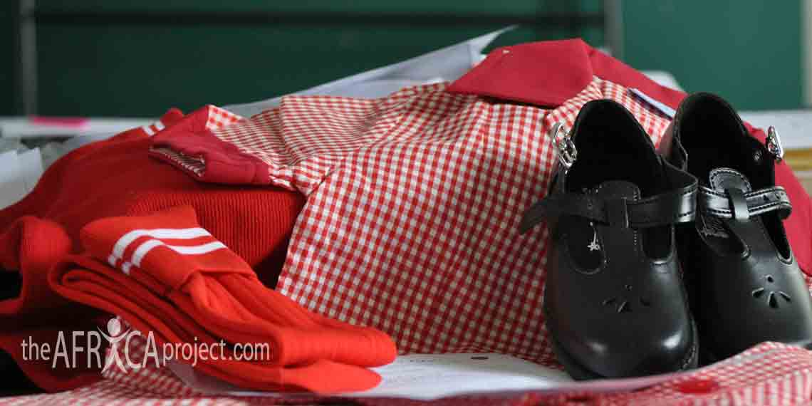 Red and white school uniform with shoes and socks