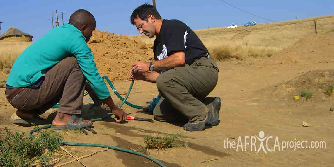 Eric helps a client install the garden hose