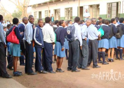 Velangaye students line up before class